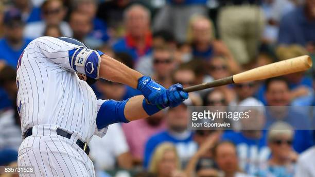 Chicago Cubs left fielder Kyle Schwarber hits a solo home run during the game between the Cincinnati Reds and the Chicago Cubs on August 17 2017 at...