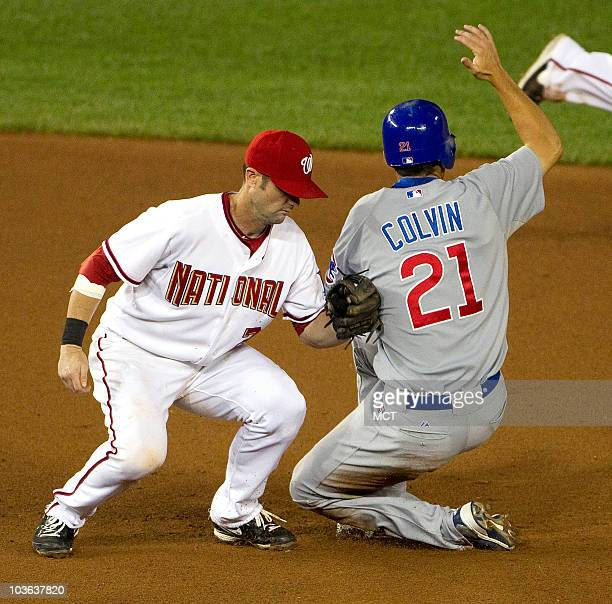 Chicago Cubs left fielder Tyler Colvin is safe at second base on a stolen base as he beats the tag attempt by Washington Nationals second baseman...
