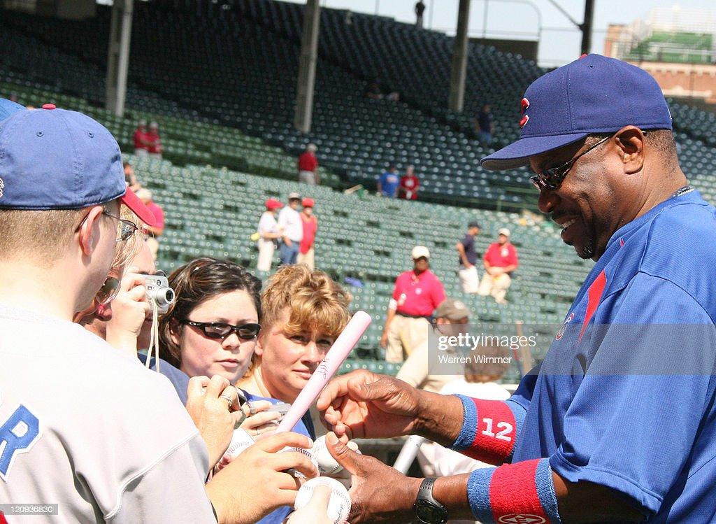 Chicago Cubs manager, <a gi-track='captionPersonalityLinkClicked' href=/galleries/search?phrase=Dusty+Baker&family=editorial&specificpeople=202908 ng-click='$event.stopPropagation()'>Dusty Baker</a>, signing autographs before the game between the Pittsburgh Pirates and Chicago Cubs at Wrigley Field in Chicago, Illinois on September 7, 2006.