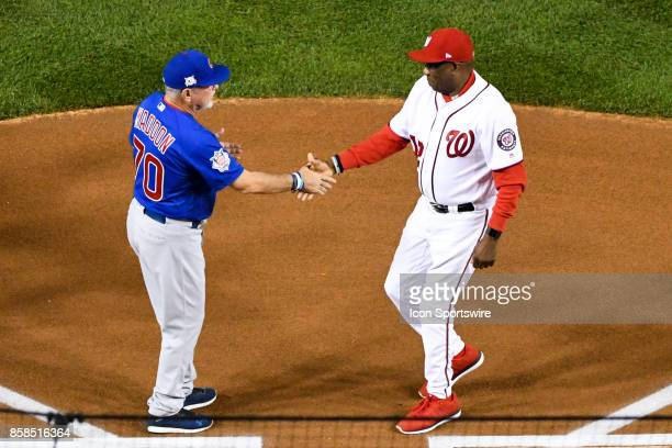 Chicago Cubs manager Joe Maddon and Washington Nationals manager Dusty Baker shake hands at home plate prior to the first game of the National League...