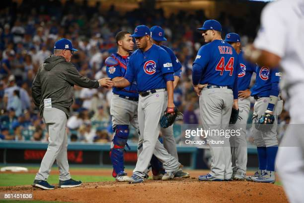 Chicago Cubs manager Joe Maddon left removes relief pitcher Hector Rondon in the sixth inning against the Los Angeles Dodgers during Game 1 of the...