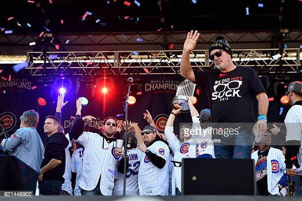 Chicago Cubs manager Joe Maddon waves as Chicago Cubs starting pitcher Jon Lester holds up the trophy during the Chicago Cubs World Series victory...