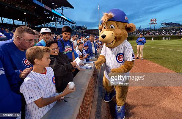 Chicago Cubs mascot Clark signs autographs for fans before the game against the St Louis Cardinals at Wrigley Field on September 24 2014 in Chicago...