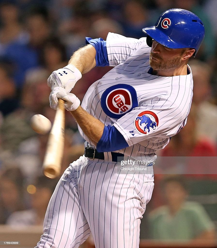 Chicago Cubs' Nate Schierholtz hits an RBI double in 3rd inning against Washington Nationals' Jordan Zimmermann at Wrigley Field in Chicago, Illinois, Monday, August 19, 2013.