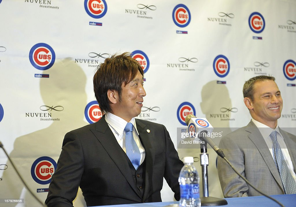 Chicago Cubs new pitcher Kyuji Fujikawa is introduced to the media as general manager Jed Hoyer watches on December 7, 2012 at Wrigley Field in Chicago, Illinois.