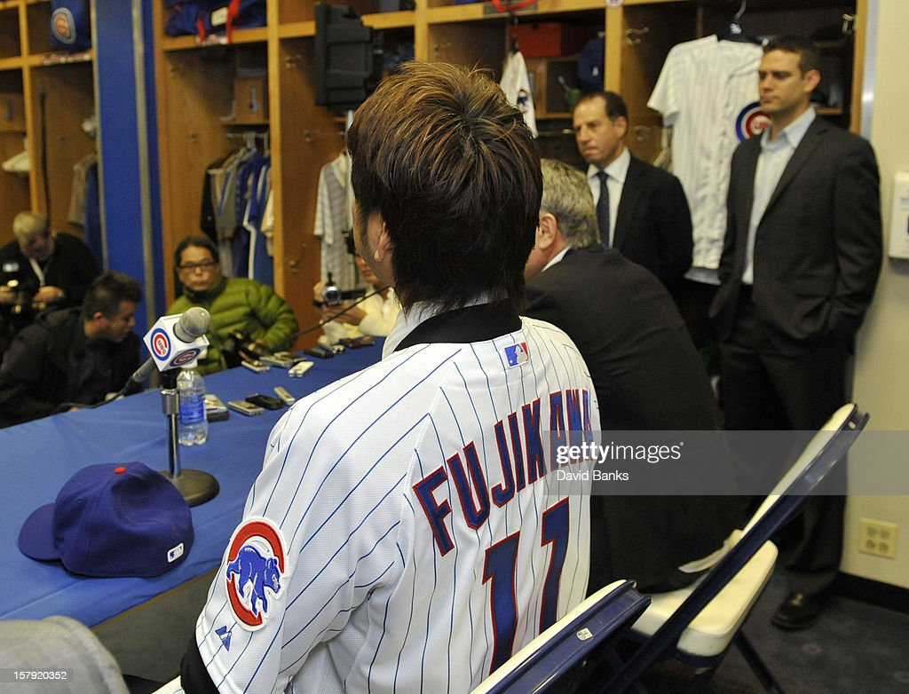 Chicago Cubs new pitcher <a gi-track='captionPersonalityLinkClicked' href=/galleries/search?phrase=Kyuji+Fujikawa&family=editorial&specificpeople=807185 ng-click='$event.stopPropagation()'>Kyuji Fujikawa</a> is introduced to the media by the Chicago Cubs on December 7, 2012 at Wrigley Field in Chicago, Illinois.