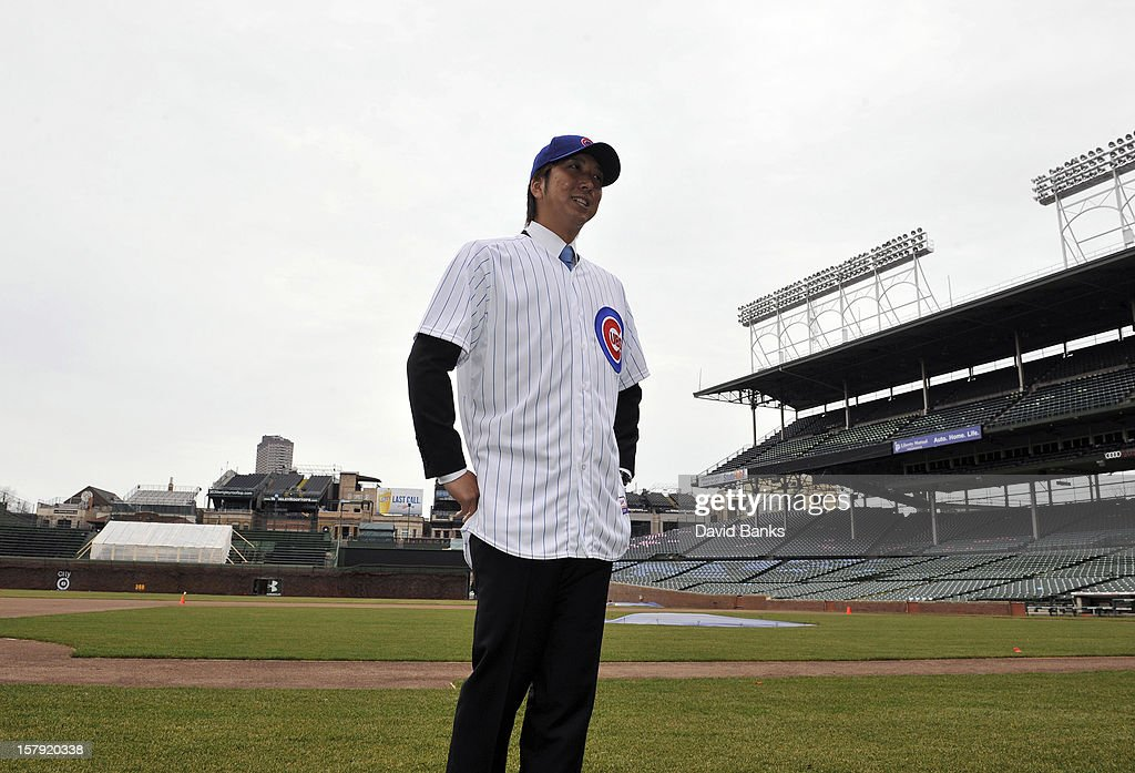 Chicago Cubs new pitcher <a gi-track='captionPersonalityLinkClicked' href=/galleries/search?phrase=Kyuji+Fujikawa&family=editorial&specificpeople=807185 ng-click='$event.stopPropagation()'>Kyuji Fujikawa</a> poses for photos on December 7, 2012 at Wrigley Field in Chicago, Illinois.