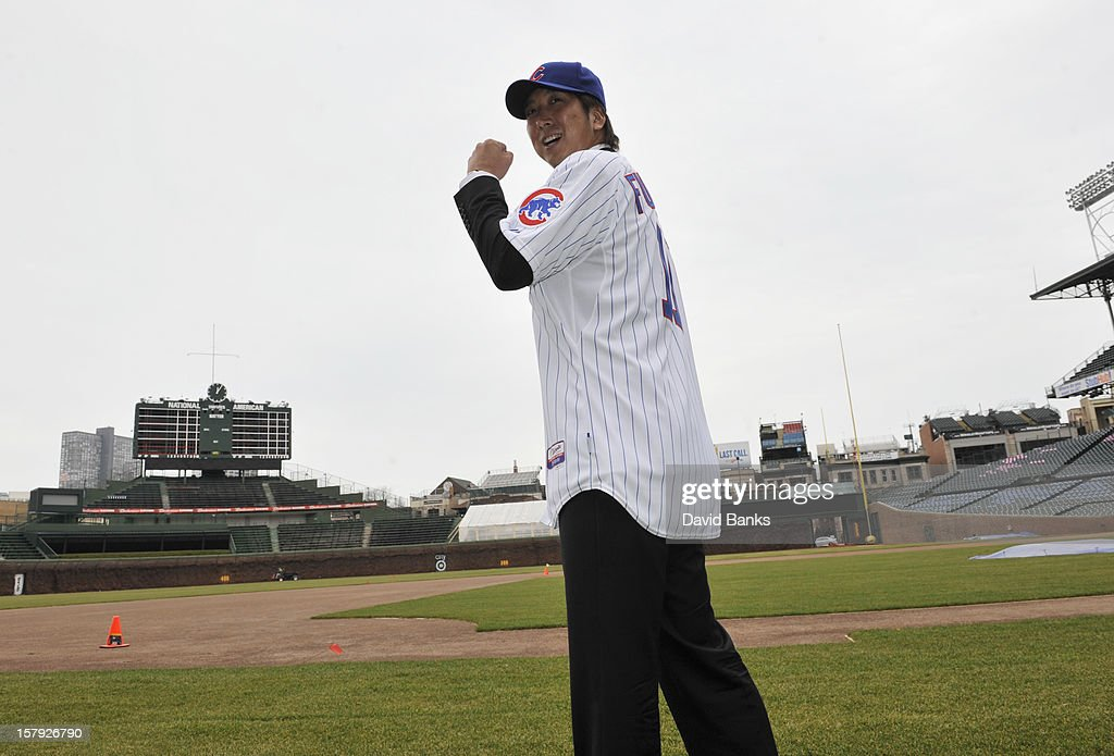 Chicago Cubs new pitcher Kyuji Fujikawa poses for photos on December 7, 2012 at Wrigley Field in Chicago, Illinois.