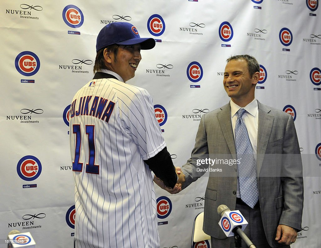 Chicago Cubs new pitcher Kyuji Fujikawa shakes hands with Chicago Cubs general manager Jed Hoyer December 7, 2012 at Wrigley Field in Chicago, Illinois.