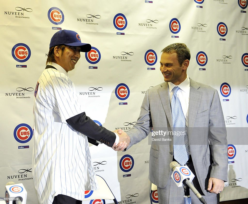 Chicago Cubs new pitcher <a gi-track='captionPersonalityLinkClicked' href=/galleries/search?phrase=Kyuji+Fujikawa&family=editorial&specificpeople=807185 ng-click='$event.stopPropagation()'>Kyuji Fujikawa</a> shakes hands with Chicago Cubs general manager Jed Hoyer December 7, 2012 at Wrigley Field in Chicago, Illinois.