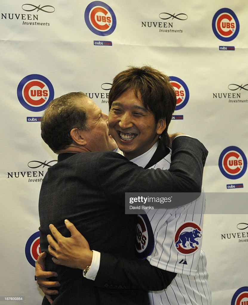 Chicago Cubs new pitcher Kyuji Fujikawa tgets a hug from his agent Arn Tellem hat December 7, 2012 at Wrigley Field in Chicago, Illinois.