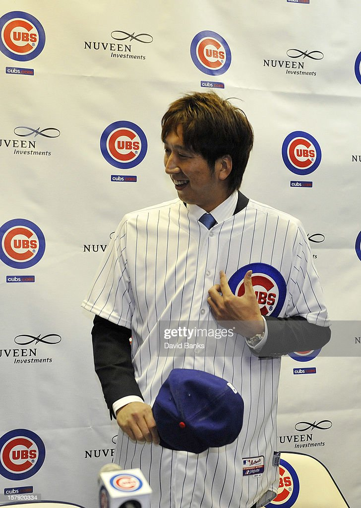 Chicago Cubs new pitcher Kyuji Fujikawa tries on his new Cubs hat December 7, 2012 at Wrigley Field in Chicago, Illinois.