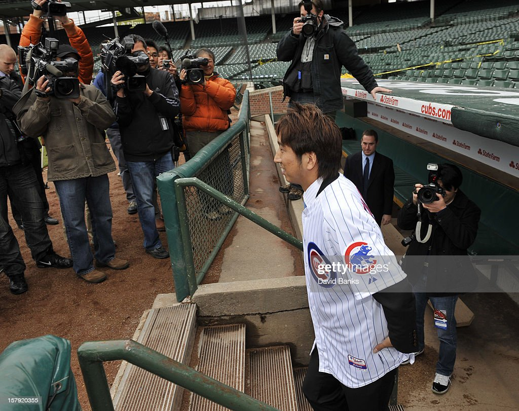 Chicago Cubs new pitcher <a gi-track='captionPersonalityLinkClicked' href=/galleries/search?phrase=Kyuji+Fujikawa&family=editorial&specificpeople=807185 ng-click='$event.stopPropagation()'>Kyuji Fujikawa</a> walks onto the field for photos on December 7, 2012 at Wrigley Field in Chicago, Illinois.
