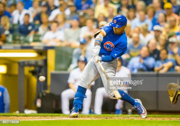 Chicago Cubs Outfield Jon Jay hits a double during the second game of the final home series between the Milwaukee Brewers and the Chicago Cubs on...