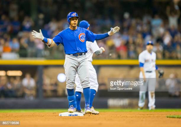 Chicago Cubs Outfield Jon Jay safe at second during the second game of the final home series between the Milwaukee Brewers and the Chicago Cubs on...