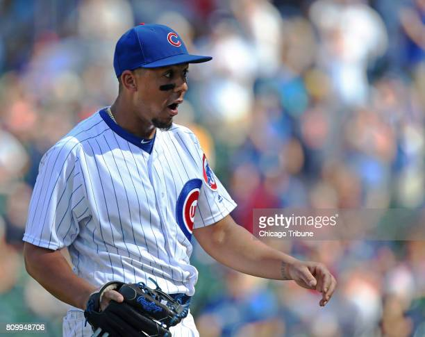 Chicago Cubs outfielder Jon Jay heads to the dugout after pitching in the ninth inning against the Milwaukee Brewers at Wrigley Field on Thursday...