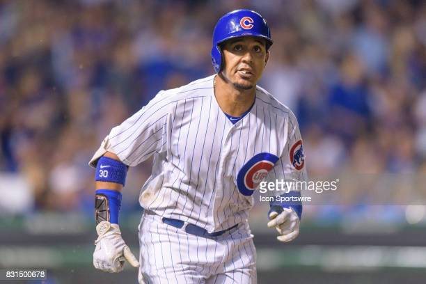 Chicago Cubs outfielder Jon Jay runs to first as his fly ball to center is caught attempting to complete a cycle in the 6th inning during an MLB game...