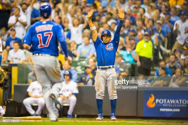 Chicago Cubs Outfielder Jon Jay waits at home to congratulate Chicago Cubs Third base Kris Bryant during the second game of the final home series...