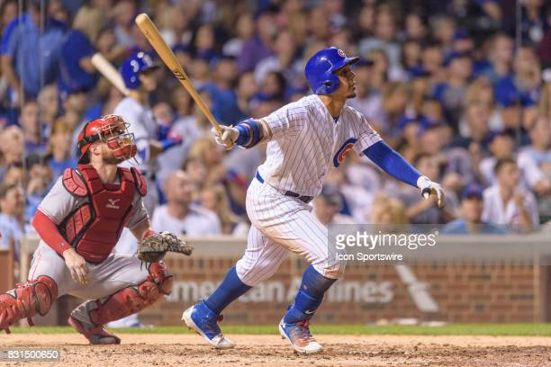 Chicago Cubs outfielder Jon Jay watches as his fly ball to center is caught attempting to complete a cycle in the 6th inning during an MLB game...