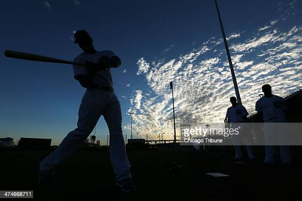 Chicago Cubs outfielder Jorge Soler left takes his turn at dawn posing for a baseball card photographer at spring training in Mesa Ariz on Monday Feb...
