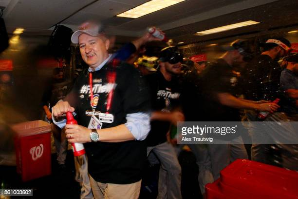 Chicago Cubs owner Tom Ricketts celebrates in the clubhouse after winning Game 5 of the National League Division Series 98 against the Washington...