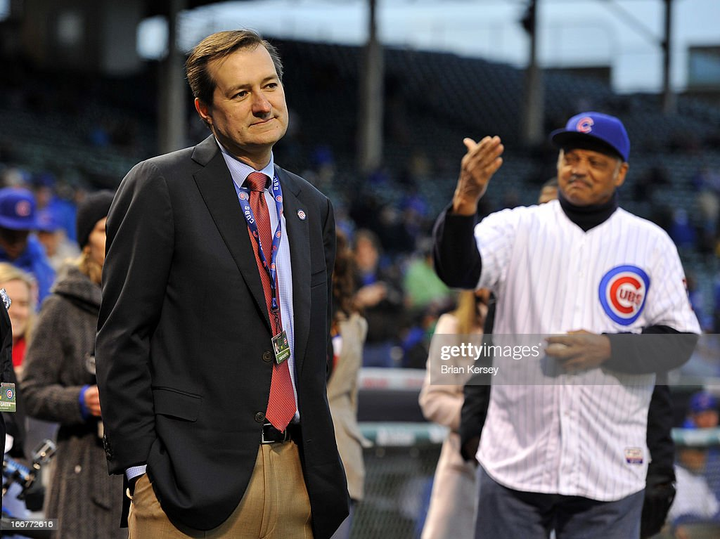 Chicago Cubs owner Tom Ricketts (L) stands on the field with the Rev. Jesse Jackson Sr. before a between the Chicago Cubs and the Texas Rangers at Wrigley Field on April 16, 2013 in Chicago, Illinois. All uniformed team members are wearing jersey number 42 in honor of Jackie Robinson Day.