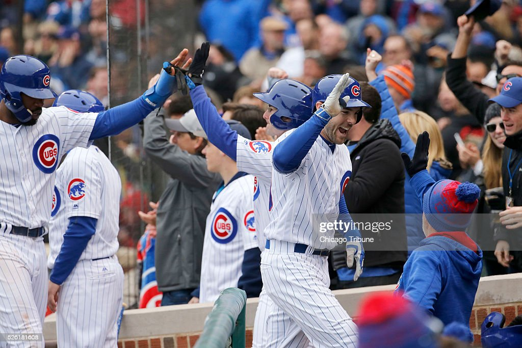 Chicago Cubs pinch hitter Matt Szczur is greeted by manager Joe Maddon, right, after hitting a grand slam in the eighth inning against the Atlanta Braves at Wrigley Field in Chicago on Friday, April 29, 2016. The Cubs won, 6-1.