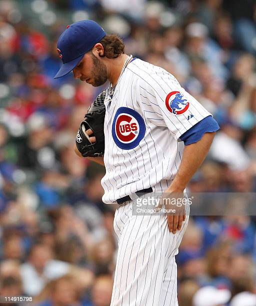 Chicago Cubs pitcher James Russell reacts after surrendering backtoback home runs the second to the Pittsburgh Pirates' Chris Snyder during the game...