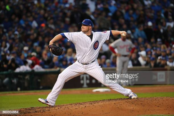 Chicago Cubs pitcher Jon Lester works in relief of starting pitcher Jake Arrieta in the fifth inning against the Washington Nationals in Game 4 of...