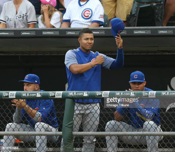 Chicago Cubs pitcher Jose Quintana waves to his former teammates while being recognized on the scoreboard by the Chicago White Sox organization...