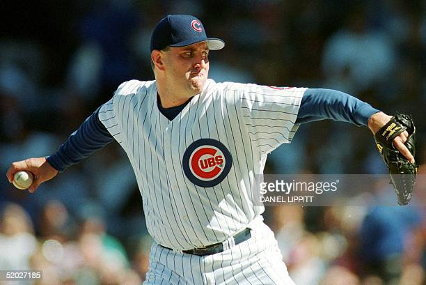 Chicago Cubs pitcher Mark Clark delivers against the Pittsburgh Pirates 09 September at Wrigley Field in Chicago IL Clark pitched sevenandtwothirds...