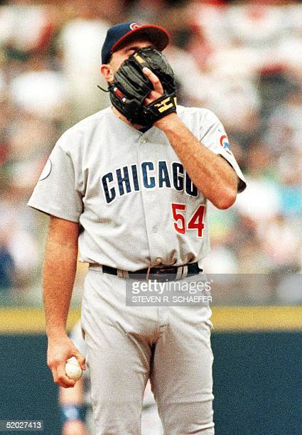 Chicago Cubs pitcher Mark Clark puts his face in his glove after walking Braves pitcher John Smoltz in the seventh inning of the first game of the...