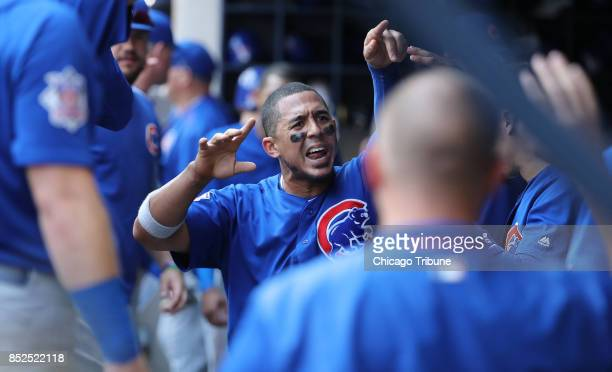 Chicago Cubs player Jon Jay is congratulated in the dugout after the top half of the 10th inning of a game against the Milwaukee Brewers on Saturday...