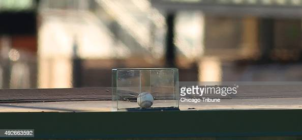 Chicago Cubs player Kyle Schwarber's home run ball is protected by a transparent box atop the right field video board at Wrigley Field on Wednesday...