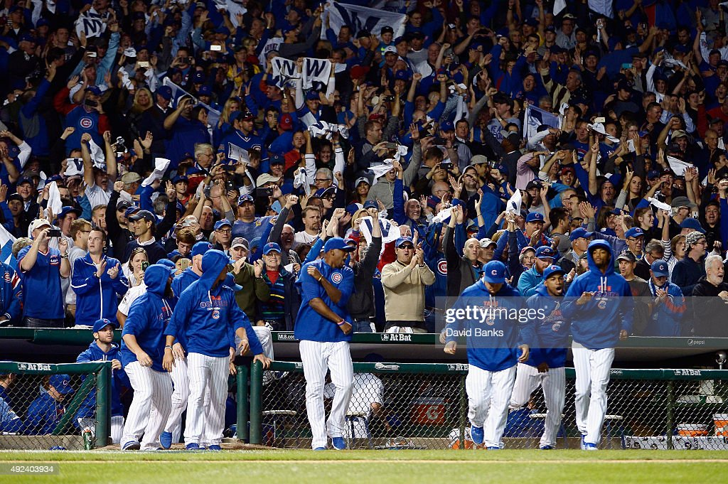 Chicago Cubs players celebrate after the Chicago Cubs defeat the St. Louis Cardinals 8 to 6 in game three of the National League Division Series at Wrigley Field on October 12, 2015 in Chicago, Illinois.