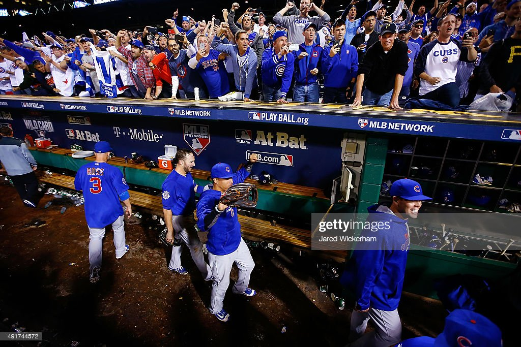 Chicago Cubs players celebrate in the dugout after defeating the Pittsburgh Pirates to win the National League Wild Card game at PNC Park on October 7, 2015 in Pittsburgh, Pennsylvania. The Chicago Cubs defeated the Pittsburgh Pirates with a score of 4 to 0.