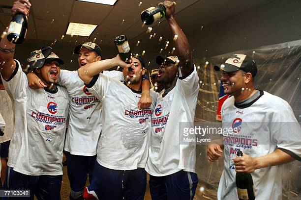 Chicago Cubs players celebrate winning the National League Central Division after they defeated the Cincinnati Reds 60 at Great American Ballpark...