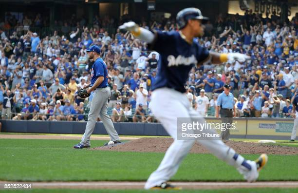 Chicago Cubs relief pitcher Wade Davis stands by after giving up a solo homer to Milwaukee Brewers hitter Orlando Arcia in the ninth inning on...
