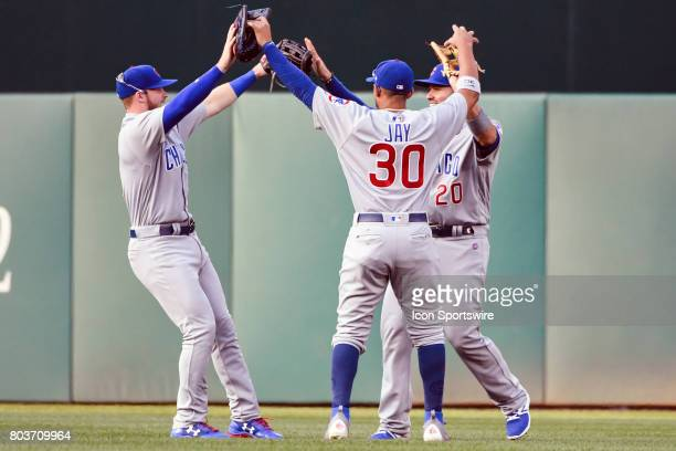 Chicago Cubs right fielder Ian Happ left fielder Jon Jay and right fielder Victor Caratini celebrate following an MLB game between the Chicago Cubs...