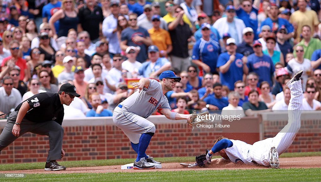 Chicago Cubs' Ryan Sweeney is tagged out at 3rd by New York Mets 3rd baseman David Wright during the bottom of the 4th inning at Wrigley Field in Chicago, Illinois, Sunday, May 19, 2013.
