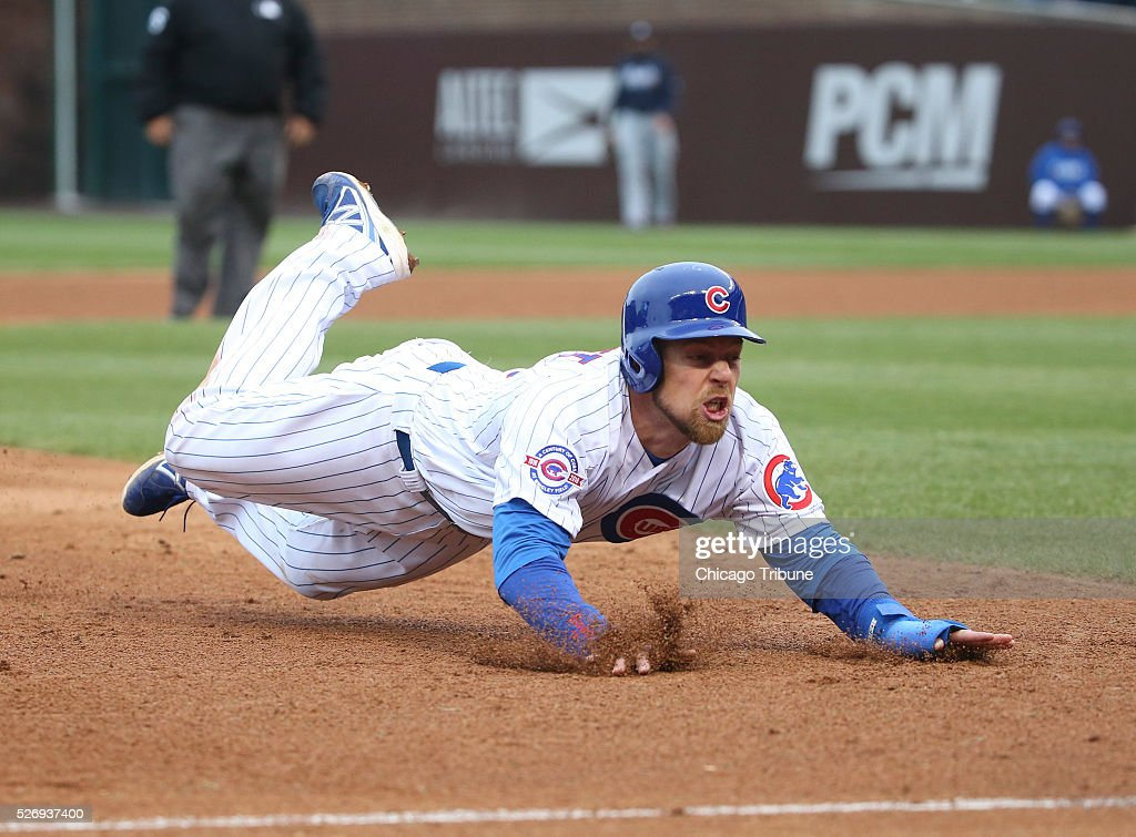 Chicago Cubs second baseman Ben Zobrist (18) dives safely into third base from first base on an error during the ninth inning on Sunday, May 1, 2016, at Wrigley Field in Chicago.