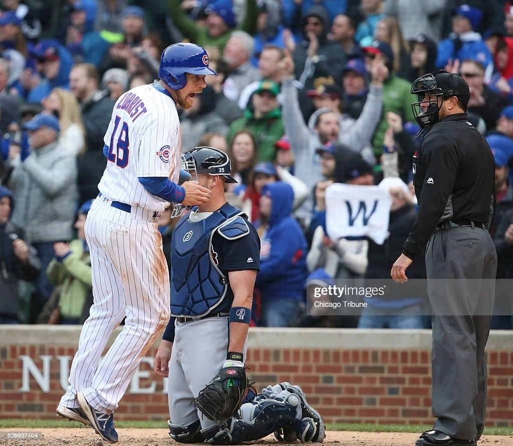 Chicago Cubs second baseman Ben Zobrist (18) scores the tying run on a single by Chicago Cubs shortstop Addison Russell (27) during the ninth inning on Sunday, May 1, 2016, at Wrigley Field in Chicago.
