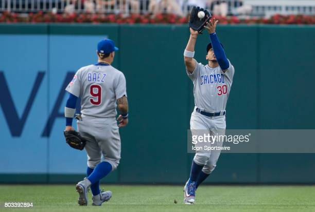 Chicago Cubs second baseman Javier Baez turns to watch left fielder Jon Jay make a play during a MLB game between the Washington Nationals and the...