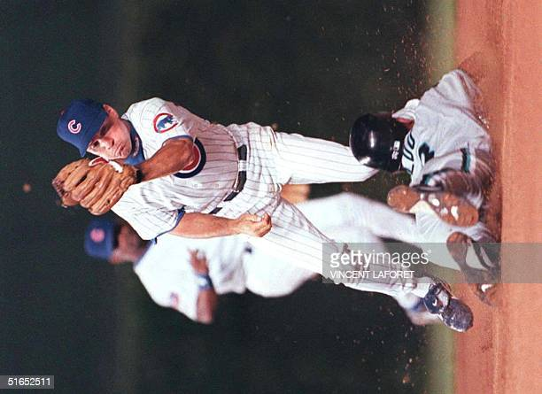 Chicago Cubs second baseman Ryne Sandberg makes the catch in time to tag out Florida Marlins Moises Alou on an attempt to steal second base in the...