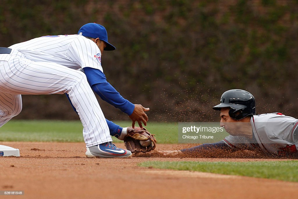 Chicago Cubs shortstop Addison Russell, left, applies the tag on the Atlanta Braves' Daniel Castro, who is caught stealing second base in the first inning at Wrigley Field in Chicago on Friday, April 29, 2016. The Cubs won, 6-1.