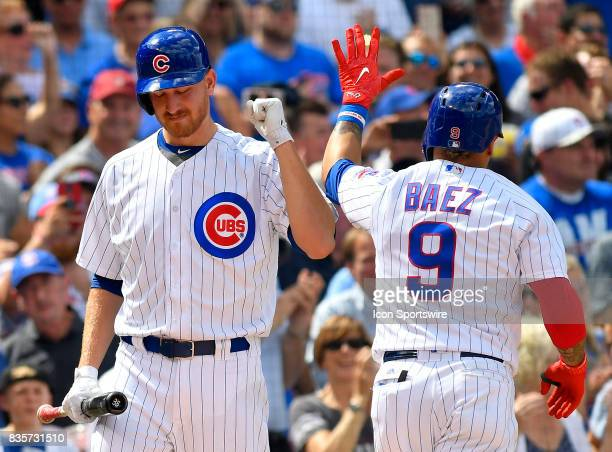 Chicago Cubs shortstop Javier Baez and Chicago Cubs relief pitcher Mike Montgomery celebrate after Chicago Cubs shortstop Javier Baez home run during...