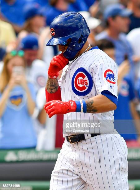 Chicago Cubs shortstop Javier Baez celebrates before tagging home plate after hitting a home run during the game between the Cincinnati Reds and the...