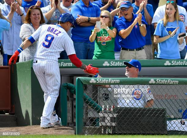 Chicago Cubs shortstop Javier Baez celebrates with Chicago Cubs manager Joe Maddon after hitting a home run during the game between the Cincinnati...