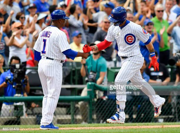 Chicago Cubs shortstop Javier Baez celebrates with Chicago Cubs third base coach Gary Jones after hitting a home run during the game between the...