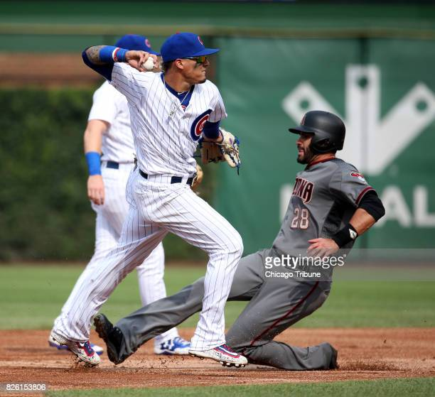 Chicago Cubs shortstop Javier Baez forces out the Arizona Diamondbacks' JD Martinez but can't complete the double play in the fourth inning on...